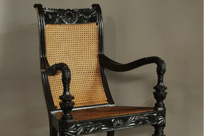 Carved solid ebony armchair