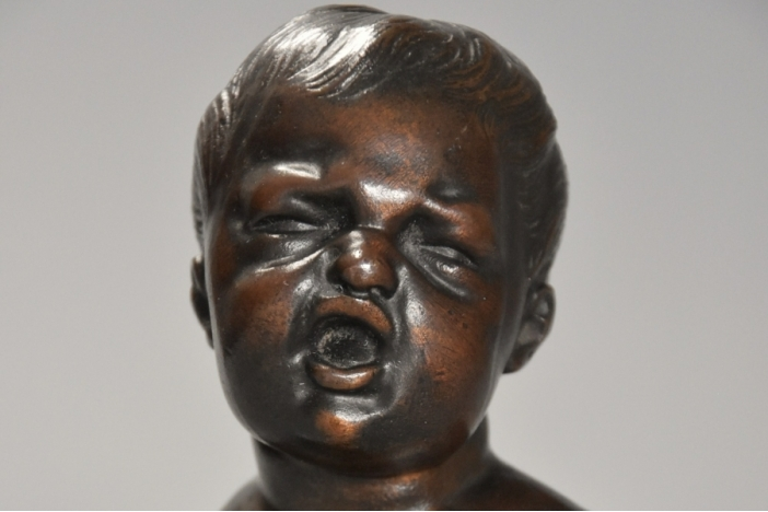 Small bronze bust of child