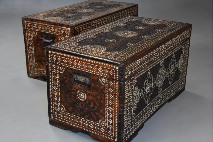 Near pair of inlaid trunks