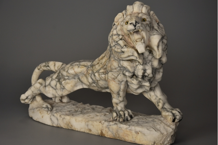 Art Deco carved marble lion