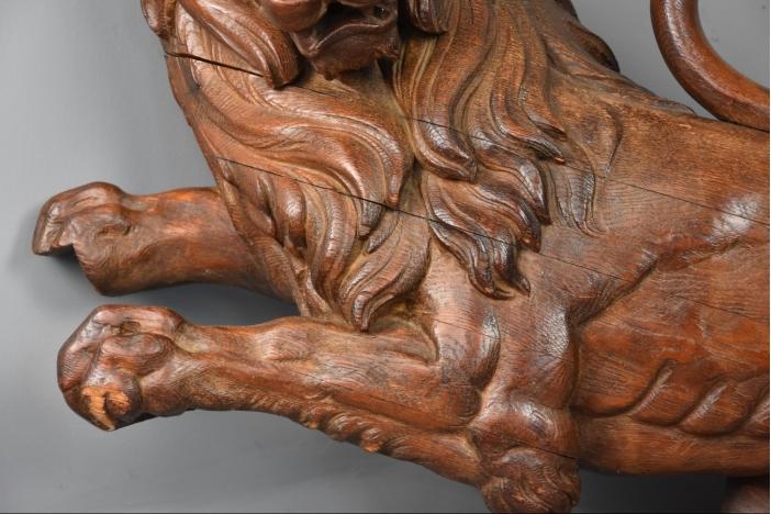 Large carved oak rampant lion