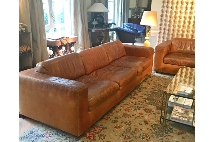 TWO LEATHER SETTEES DURLET