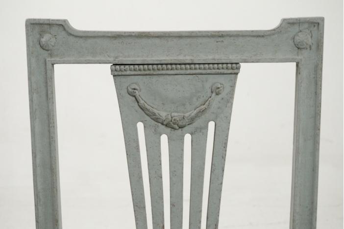 Sixteen Gustavian style chairs