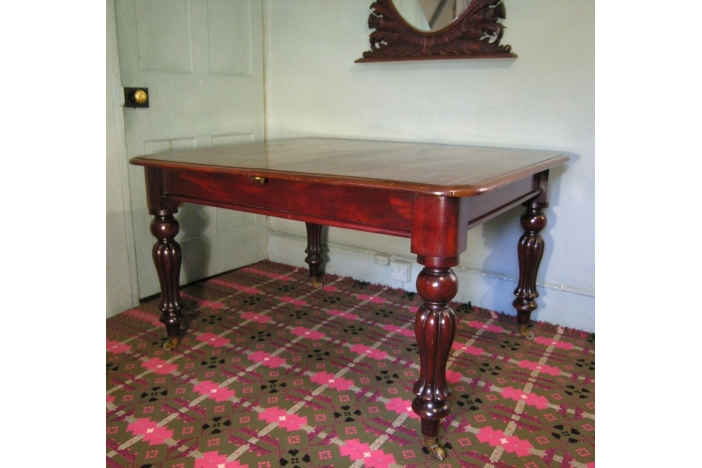 19TH C. MAHOGANY DINING TABLE
