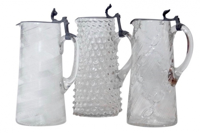 Three 19th century glass jugs