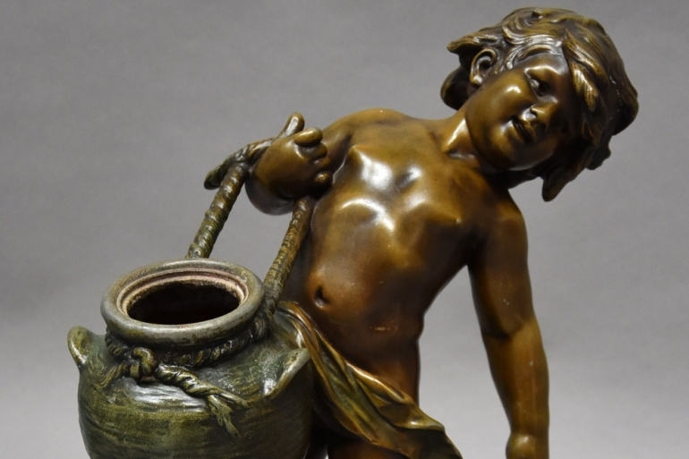 Bronzed spelter water carrier