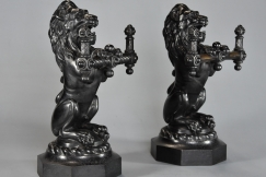 Pair lion cast iron fire dogs