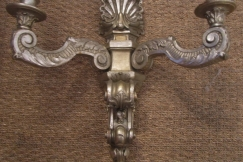 four silver gilt wall sconces