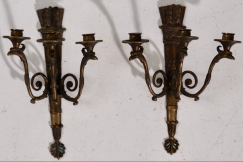 Charming bronze wall lamps.